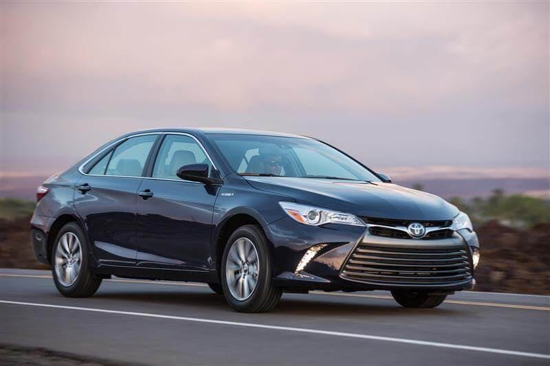 Certified Pre-Owned 2016 Toyota Camry driving down the highway