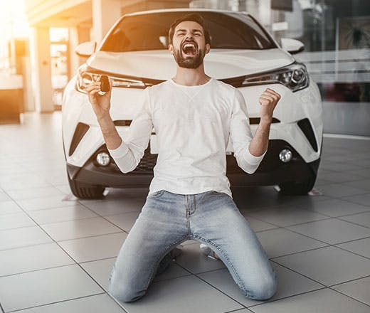 Happy guy with new car