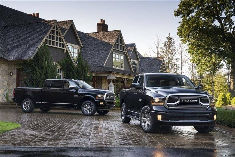 Two RAM 1500 trucks posed outside of High Park home