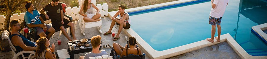 group of young adults by pool