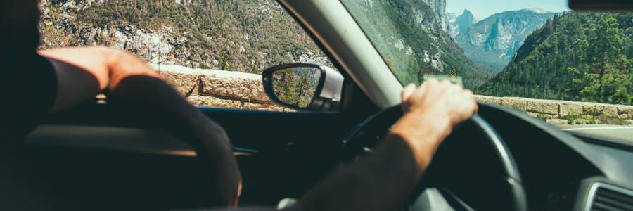 man driving through the mountains