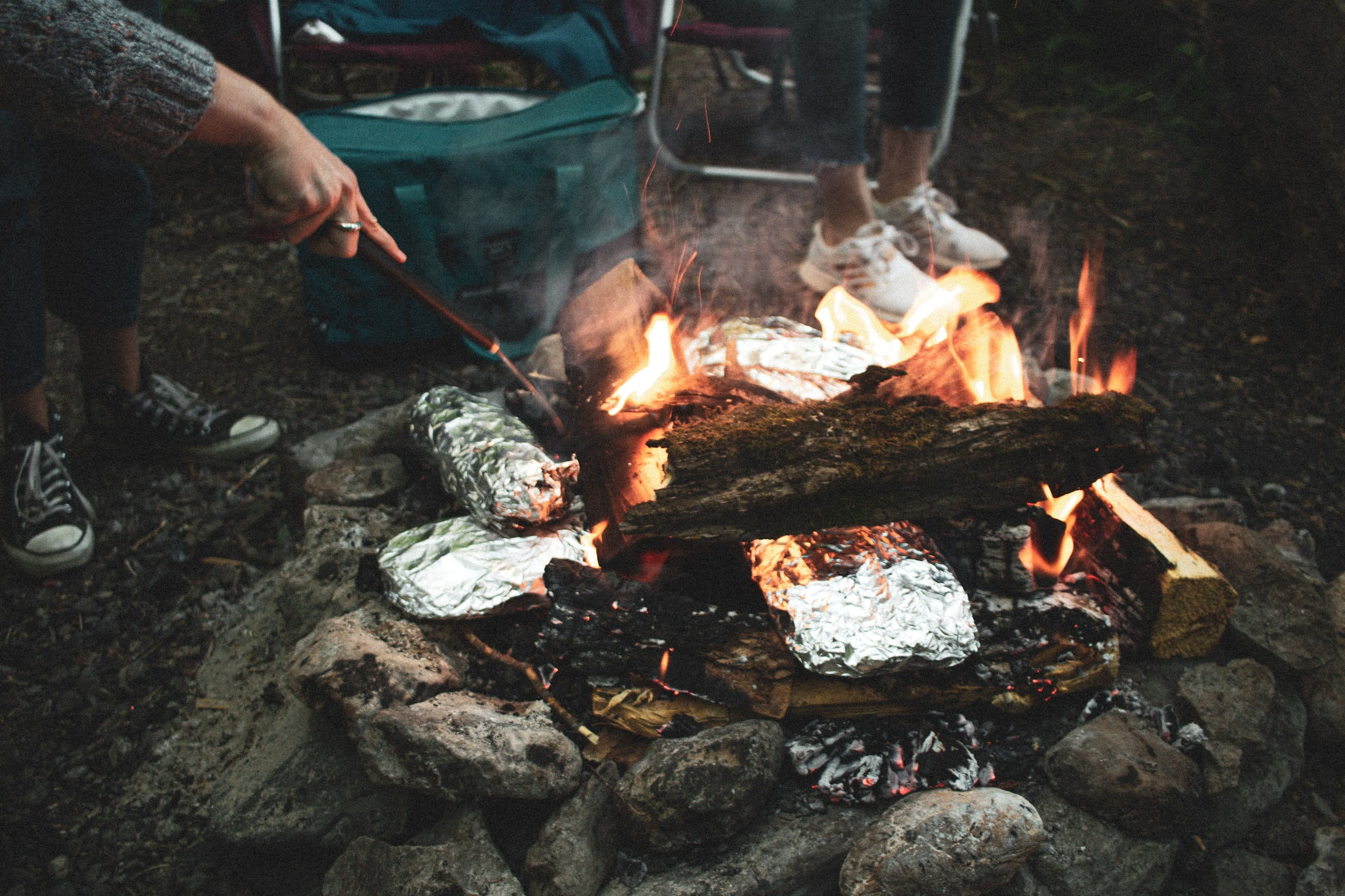 People cooking around a campfire