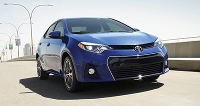 Blue 2016 Toyota Corolla Driving on a bridge