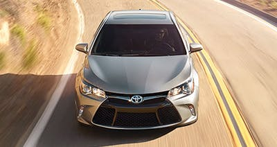 Grey 2016 Toyota Camry on highway