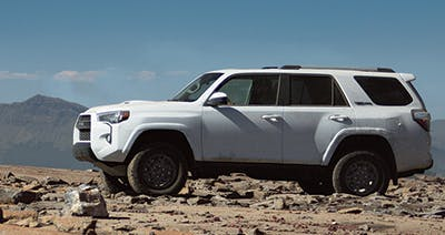 White Toyota 4Runner on gravel