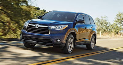 Blue 2016 Toyota Highlander on highway