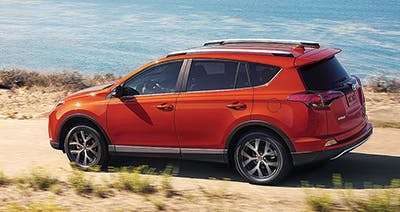Orange 2016 Toyota Rav4 by the beach