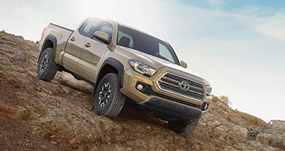 Brown 2016 Toyota Tacoma off-roading