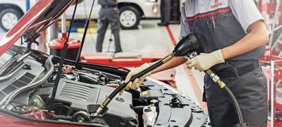 Toyota mechanic changing oil