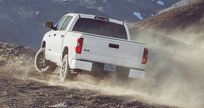 White 2016 Toyota Tundra driving on a mountain