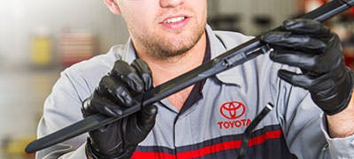 Toyota mechanic inspecting wipers