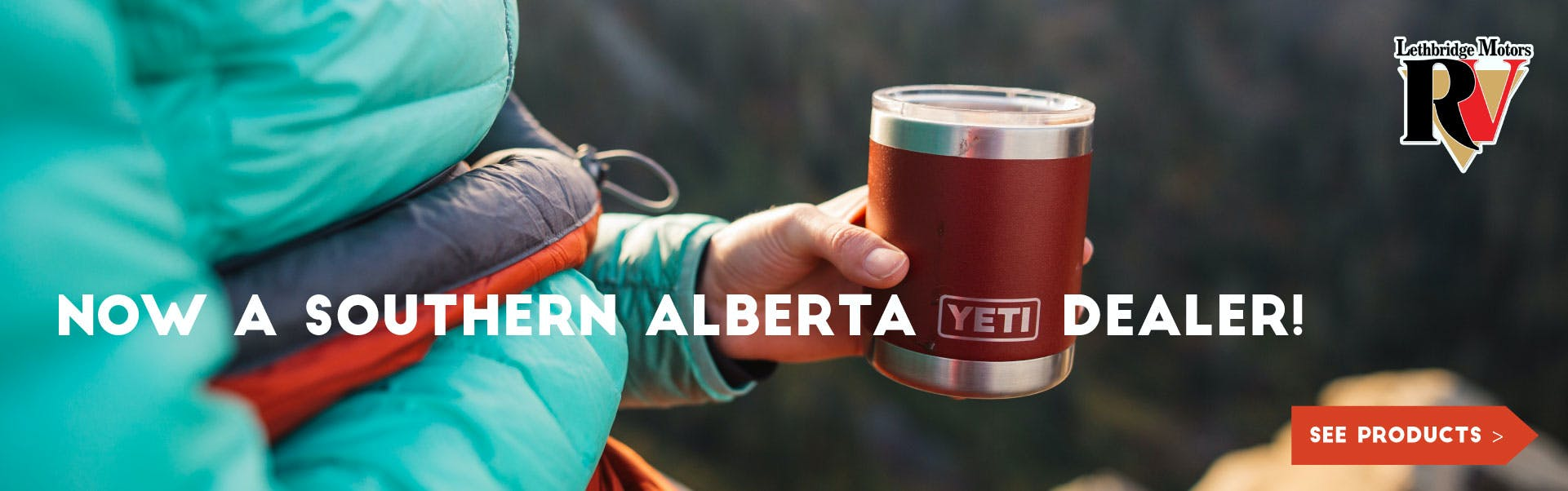 woman camping and drinking tea out of a red yeti coffee mug
